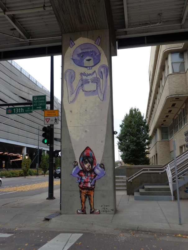 street-art-denver-by-choe-performing-arts-complex-across-from-convention-center-on-13th-denver-downtown by David Choe